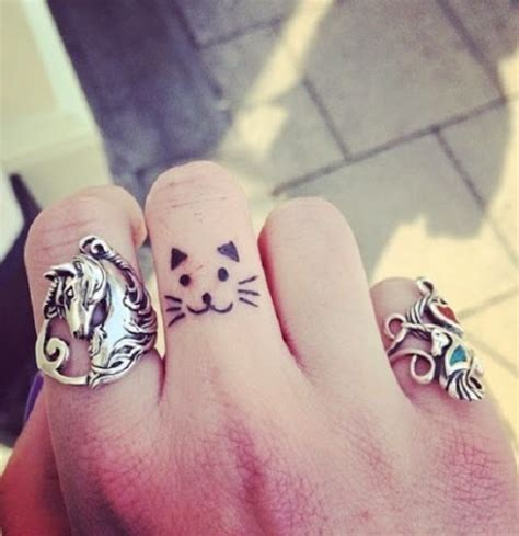 cat tattoo on finger 22 small cat tattoo ideas for ladies styleoholic