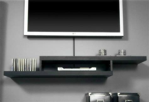 Wall Shelf For Electronics by Wall Mounted Tv With Wall Mounted Shelves Home Decorating Ideas