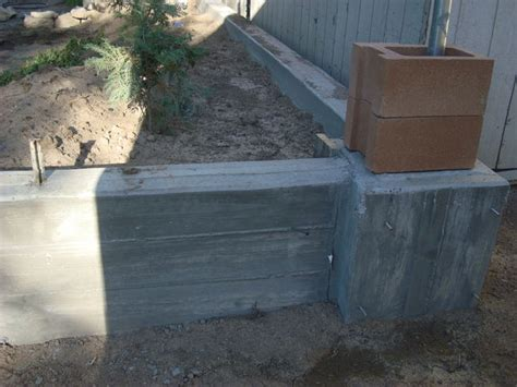 retaining wall and footer pouring concrete all