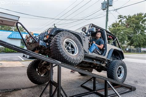 lowered 4 door jeep wrangler flexing for fun with low range 4x4 drivingline