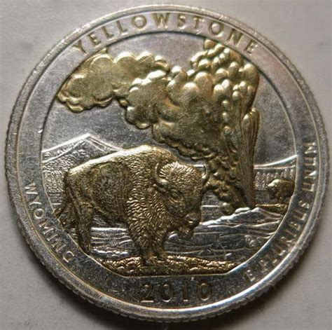 gold colored quarter yellowstone quarter with partial gold colored plating