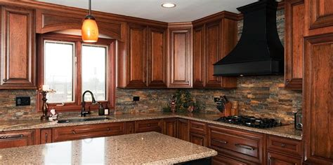 kitchen backsplash cherry cabinets cherry cabinets and stone backsplash kitchen pinterest