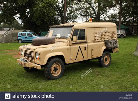 land rover desert army land rover in desert camouflage stock photo