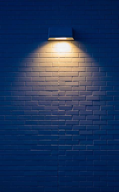 white wall yellow lamp minimal decoration