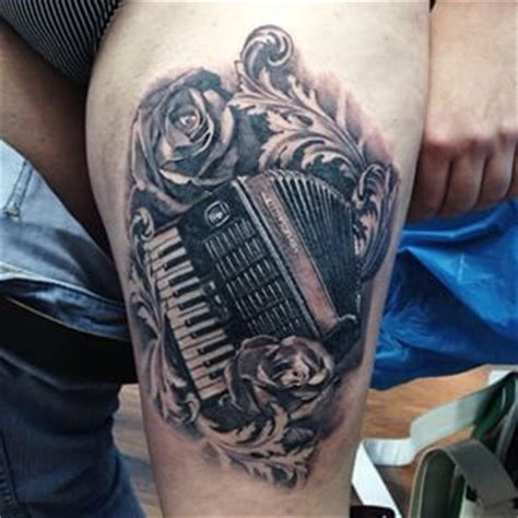 accordion tattoo tattoos 12 charming accordion tattoos for all you