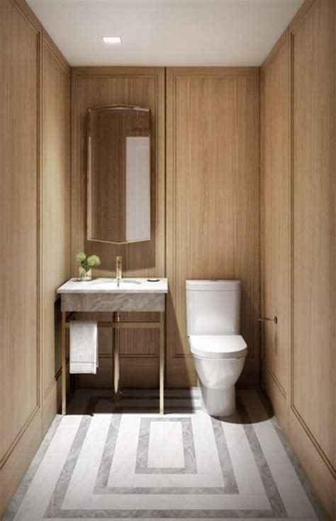 warm bathroom tiles warm wood walls with millwork brass sink fixture and