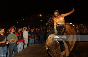 Woman rides the mechanical bull in the full throttle saloon during