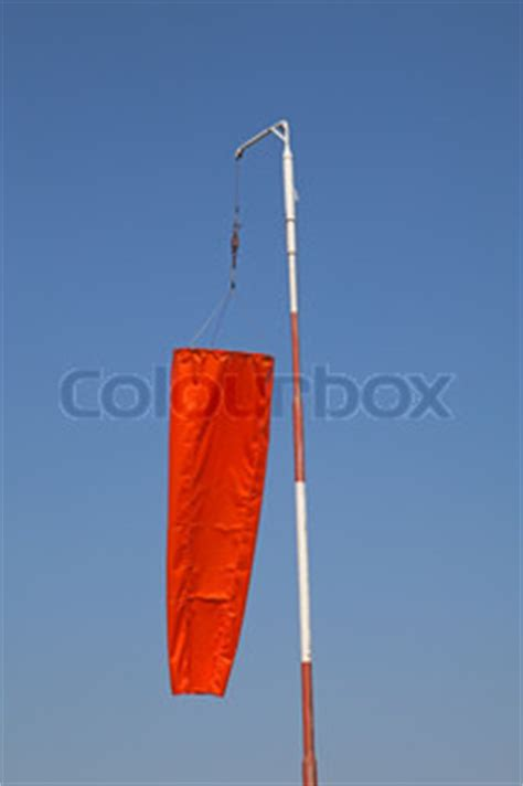 """""""windsock"""" showing no wind on the airfield   stock photo"""