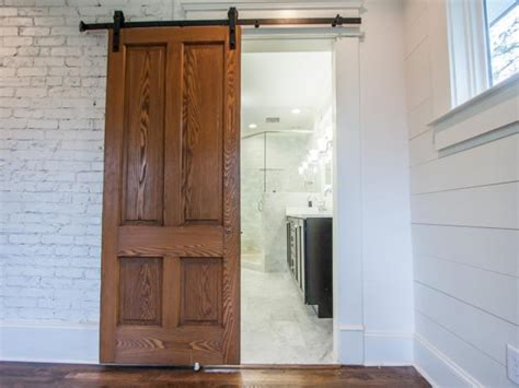 how to fix a door that keeps swinging open how to install barn doors diy network blog made