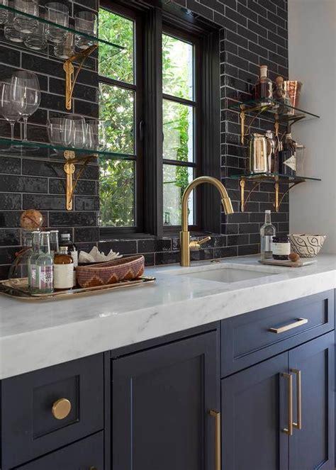 dark cabinets countertop backsplash cabinet handles basement wet bar with built in shelves transitional