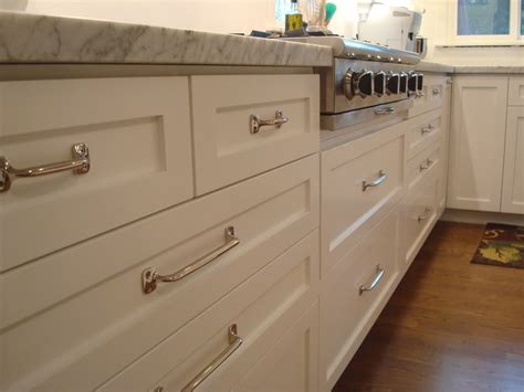 kitchen cabinets knobs vs handles knobs or pulls on cabinets function vs look in kitchen