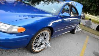 Buick Lacrosse On Swangas Slabs Crusing Through Chicano Park Swangas On Everything