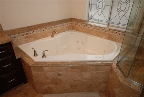 traditional bathtub corner tub shower seat master bathroom reconfiguration