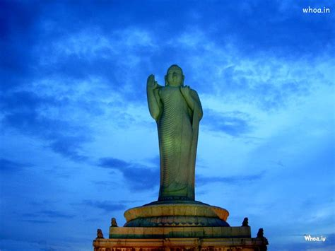 lord buddha white granite rock stands atop  lotus