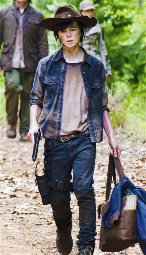 The Walking Dead Carl Grimes Poncho carl grimes quot strangers quot he has come a way from a boy to a strong