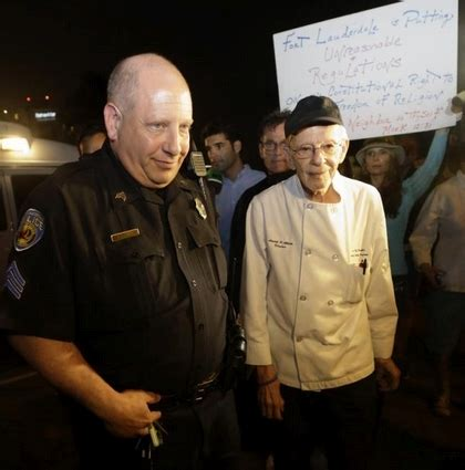 cop's cowardly act, arresting those who feed the homeless