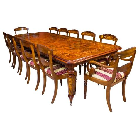 style marquetry dining table and 12 chairs at