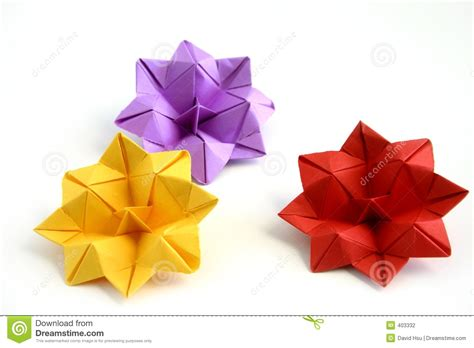 Small Origami Flowers - three origami lotus flowers stock photography image 403332