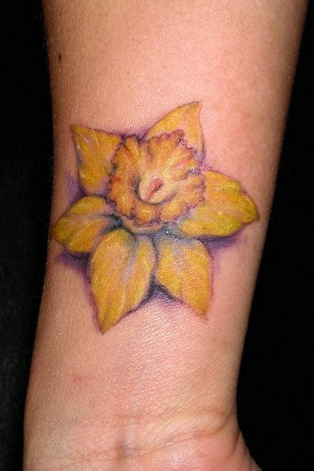 daffodil wrist tattoo daffodil tattoos designs ideas and meaning tattoos for you