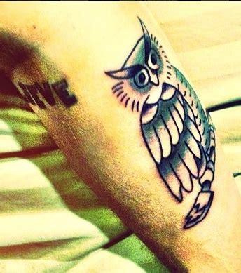 photo : tatouage de justin bieber sur l'avant bras