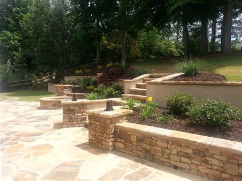 tiered retaining wall pit and large patio forsyth