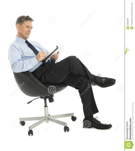 White Sitting Chair Businessman Writing In Note Pad While Sitting On Office