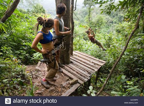 spanish tourists zip lining  tree house   landing
