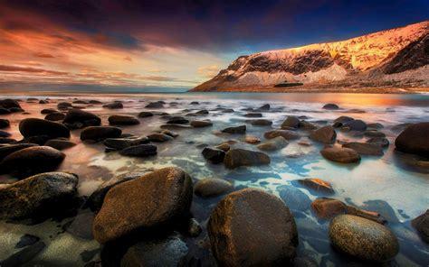 unstad lofoten islands norway sea coast sea beach rock red
