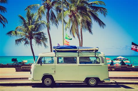 volkswagen bus beach free images water sand sky sunshine automobile