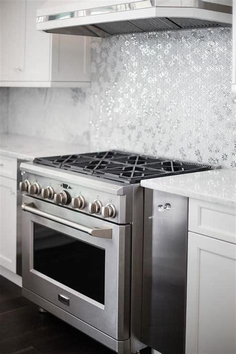 metallic kitchen cabinets ivory and white kitchen with gray metallic tile backsplash