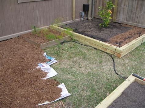 how to kill grass in flower beds easily kill grass or weeds by laying down newspaper then
