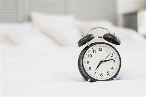 alarm clock  bed  white linen photo