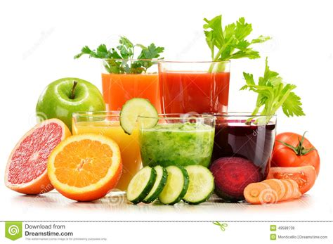 Detox With Fruits And Vegetables Juicing by Glasses With Fresh Organic Vegetable And Fruit Juices On
