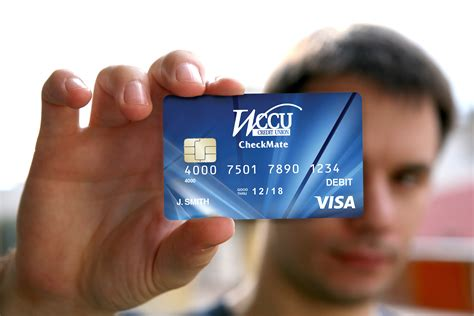 Holding Credit Card Template Holding A Blank Id Card With Chip Wccu Credit Union