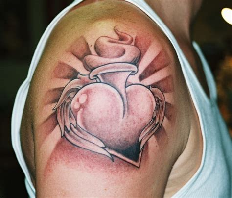 heart tattoo on shoulder sacred on shoulder