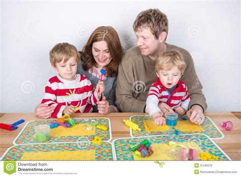 fun home a family happy family of a four having fun at home royalty free stock photos image 31245278