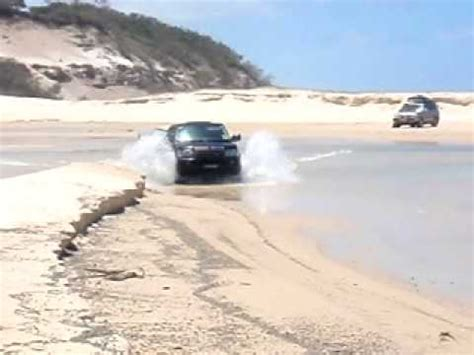 range rover sport crossing eli creek on fraser island