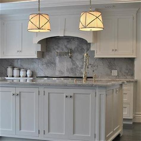 white kitchen cabinets with gray marble backsplash