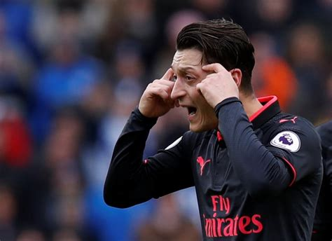 alexis sanchez gloves arsenal news ozil throws gloves off in reaction to