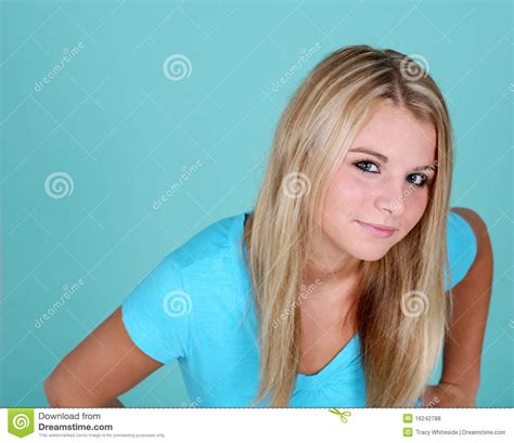 small teen blonde teen on blue background stock photo image 16242788