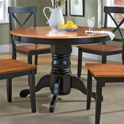 pedestal casual dining table in black and cottage