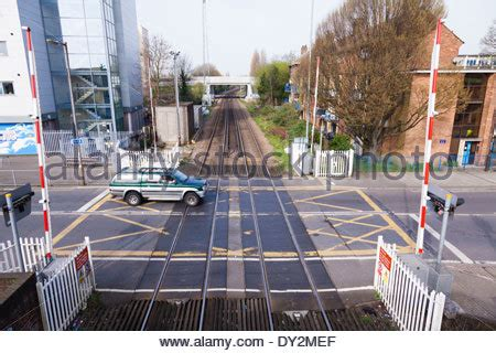 british railway level crossing barrier gate closed before