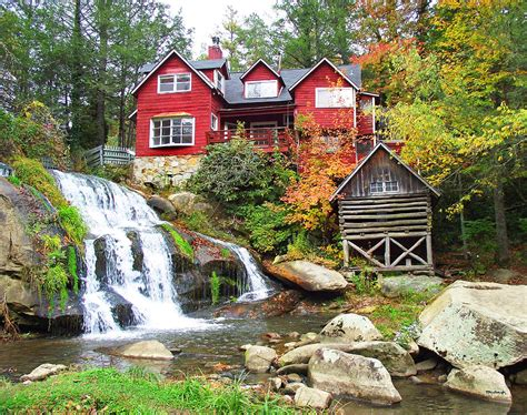 house with waterfall red house by the waterfall photograph by duane mccullough