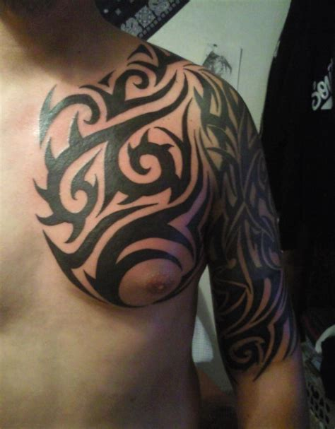 tribal tattoos chest to shoulder 45 tribal chest tattoos for