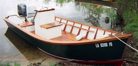 wooden sw boat lumber yard skiff another one