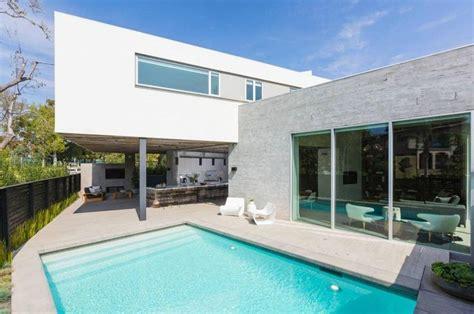rocker travis barker buys ultra modern house where a 1950