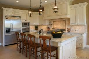 Designs for kitchens using white kitchen island and brown cabinet