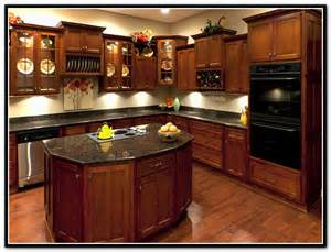 Long Bookshelves by Light Granite Countertops With Cherry Cabinets Home
