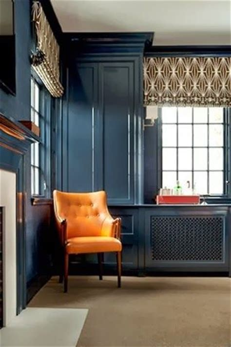 boston based interior designer annsley mcaleer chocolate orange paint colors and orange chairs