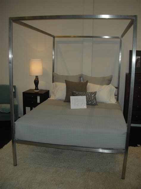 room and board bunk beds the portica queen canopy bed totally channels miranda